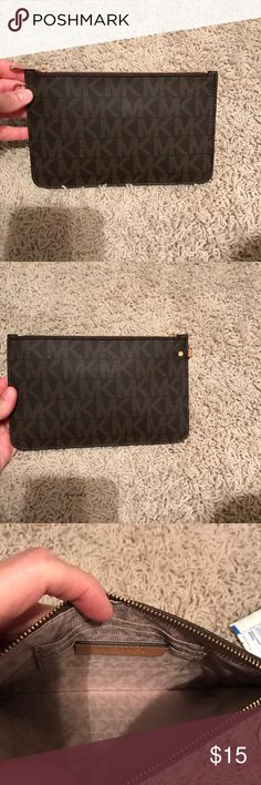 Brand new Michael Kors wallet pouch Brand new came with a bag I purchased and I won't be needing this. I would say it's a large wallet bc it has credit card slots or a medium clutch. Flat and zips. FREE IF PURSE BOUGHT. Michael Kors Bags Clutches & Wristlets