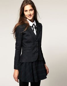 We love sets in clothes because they are always a fashion success. Plaid or tartan in blue is the perfect print for school uniforms. Wear it with a white shirt, a black bow, black tights and classic oxfords.