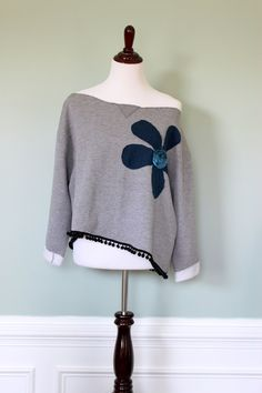 Women's Funky Boho Upcycled Eco Friendly Oversized Asymmetrical Off Shoulder Sweatshirt with Large Flower Applique and Pom Pom Fringe. $28.00, via Etsy.