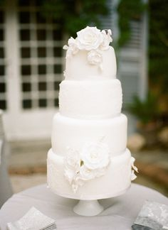 Elegant white wedding cake: http://www.stylemepretty.com/destination-weddings/2015/01/05/black-tie-french-chateau-wedding/ | Photography: Christina Brosnan - http://www.brosnanphotographic.com/