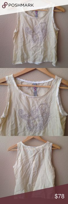 NWOT Johnny Was/ Biya  Silk and lavender  paisley NWOT. from the fabulous Johnny Was/ Biya. Dainty and delicate cream silk tank top. Lavender embroidered paisley pattern on front Edges trimmed in lace and hand crochet. Size Medium. Only reasonable offers please. Free People Tops Tank Tops