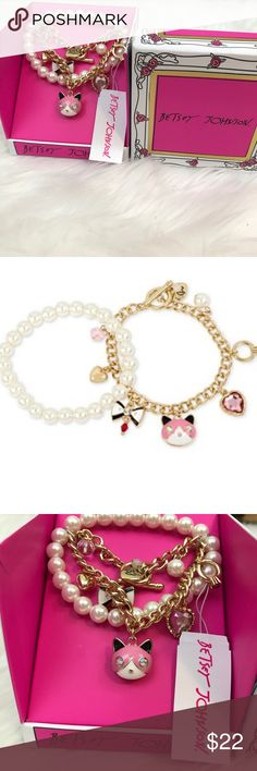 Betsey Johnson 2 piece Cat charm bracelet NWT set New with tags two piece gold tone cat charm and imitation peal bracelet set. Betsey Johnson. Mixed metals gold tone. Imitation pearl bracelet is a stretch bracelet. It is approximately 2-1/4 inches in diameter. The cat charm bracelet has a toggle closure. Approximate length is 7-1/2 inches. They come packaged in a beautiful gift box. Betsey Johnson Jewelry Bracelets