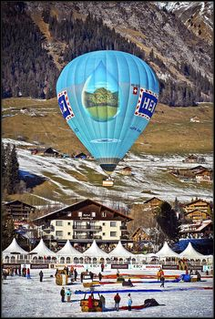 Festival de ballons, Château- d'Oex, Switzerland  this brings back great memories of crewing in France on our honeymoon in the snow~