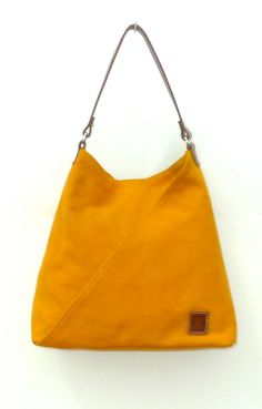 Mustard canvas and natural leather handbag