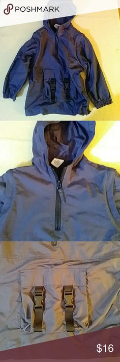 Old Navy navy blue hooded windbreaker-sz 4\5 NWOT. Pullover with short front zipper. Front pocket. 100% nylon. 20 1/2 inches long measured from center back neck.  Armhole to armhole is 17 inches.  Sleeves are 12 inches long from underarm. Old Navy Jackets & Coats Raincoats