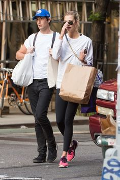 Match made!The 29-year-old investor matched his lady with his wardrobe, donning a white T...