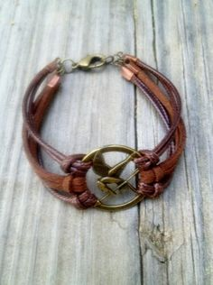 Bronze Mockingjay Bracelet with Brown Leather and Suede ($12.50 on Etsy) http://sulia.com/channel/the-hunger-games/f/0f5cf7ef-f78e-4a25-a916-d52bb7ada1b9/?pinner=39289531