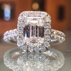 http://rubies.work/0436-sapphire-ring/ Stunning 2.14 Emerald cut surrounded by a diamond halo. Available at Alson Jewelers. Call 216-464-6767 for more information. www.alsonjewelers.com