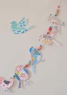 Make this beautiful bird garland with clip art from The Ink Nest, and dyed wooden beads. It's such a simple and colorful decoration for Easter!
