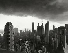 """August 29, 1950. """"Storm over Manhattan. New York: The towering buildings of Manhattan are silhouetted against heavy clouds which gathered over the city just before a sudden electrical rainstorm late in the afternoon of Aug. 29. This view looks south from the area of Central Park."""" Acme Newspicture. Shorpy Historic Picture Archive"""