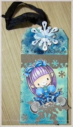 Christmas tag made using Birdie Brown image coloured with Prismacolor pencils. Snowflakes cut using Cricut Artbooking cartridge.