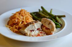 Roasted Red Pepper and Goat Cheese Stuffed Chicken Breasts make dinner super fancy and super easy at the same time!