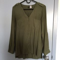 H&M olive green flowy button up Cute H&M button down blouse! Worn once- in perfect condition! Sleeves roll up with buttons to hold in place, 2 breast pockets. Light, flowy material...100% polyester. H&M Tops Button Down Shirts