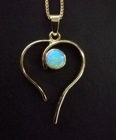 Trouwring getransformeerd tot hanger - Juwelier de Tijd | Persoonlijk advies over trouwringen, sieraden en taxaties