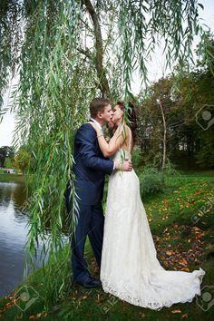 Romantic Kiss Bride And Groom On Wedding Walk Stock Photo, Picture ...
