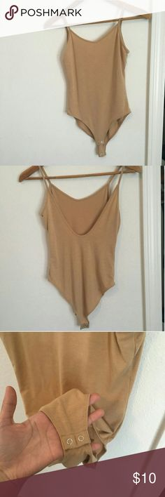 Cute Low-back Nude Bodysuit!! Nude color bodysuit from Forever 21. Worn once ! Super cute but it doesn't suit my skin tone. Size S Forever 21 Other
