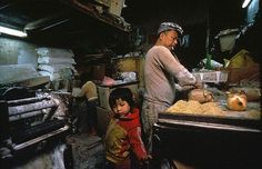 The pasta-factory of Hui Tung Choy in Kowloon Walled City was at the same time the living room of his family. His daughters helped working, played and did their homework in the same space. Picture by Greg Girard