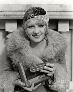 Anita Page shows off a new compact camera that fits into a small case. (Bizarre Los Angeles)