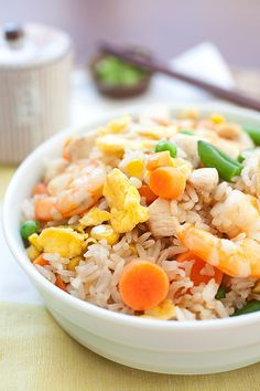 Fried Rice is the popular Chinese food. Easy fried rice recipe with overnight rice, eggs, chicken, shrimp that tastes much better than takeout.