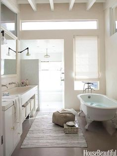 Relaxed Industrial     In the master bathroom of her light-filled home with a loft-like feel, photographer Amy Neunsinger combined an elegant claw-foot tub with a casual woven rug.     The Best Bathrooms of 2010 - Photos of 2010 Bathroom Designs - House Beautiful