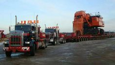 "rollerman1: ""A Hitachi EX5500 excavator being pushed & pulled with some KW heavy haul trucks. """