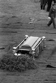 November 25, 1963: The funeral over, JFK's casket lies waiting to be buried.