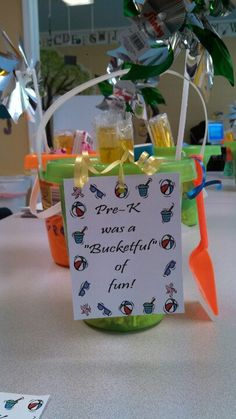 "End of the year gift for my students. The shovel says: Mrs. Laurie ""digs"" me. Inside the bucket is summertime fun stuff: freezer pops, bubbles, sidewalk chalk, a pinwheel, glow in the dark silly putty, etc."