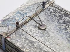 Layers of Wall Paint III — Dovilė Bernadišiūtė — back detail  - Brooch: Layers of wall paint III, 2014 - Dry paint, Titanium, stainless steel 11x6x1,8 cm From series: Layers of Paint