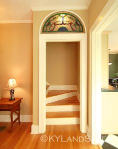 I love this transom window above the stairs.  http://www.kylandsales.com/309Bragg/HistoricPerryvilleKYCottageforSale.html
