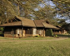Oltukai Lodge- is set in Amboseli National Park surrounded by endless plains and, after the rains, shallow lake land. All cottages face the open plains with Mount Kilimanjaro offering a magnificent backdrop to the setting. There are 80 chalet-style twin rooms at Ol Tukai Lodge, all with an uninterrupted view of the wetlands or Kilimanjaro. The rooms are built from gum trees, local river stone and slate. All rooms are comfortably furnished and have private bathrooms and individual Mount Kilimanjaro, Chalet Style, River Stones, Lodges, Kenya, Habitats, Trip Advisor, Woodland, National Parks
