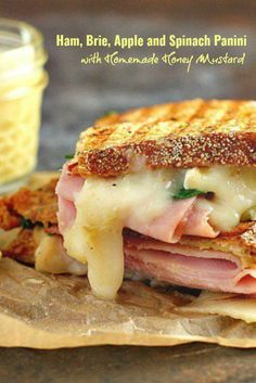 This Ham, Brie, Apple and Spinach Panini with Homemade Honey Mustard is a delicious combination of flavors for gourmet sandwich lovers everywhere! Plus its a great way to use up leftover Easter ham! Brie Sandwich, Grilled Sandwich, Soup And Sandwich, Gourmet Sandwiches, Panini Sandwiches, Sandwiches For Lunch, Vegetarian Sandwiches, Panini Recipes, Pork Recipes