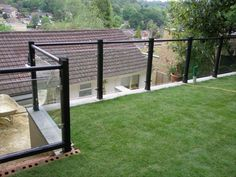 Glass balustrades attached to timber decking with for Garden decking glass panels