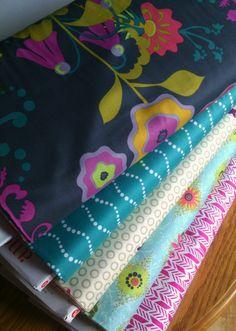 Alison Glass Fabrics Bundle Includes:  Clover sunshine globe in snow  Sunprint feathers in pink  Sunprint bike path in aqua  Field day spent