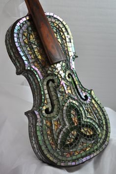 This Celtic designed violin brings to mind the beautiful Irish music that once came from it.  Now it is a work of art that anyone can enjoy.  The iridescent glass reflects the light in a myriad of ways, so it has a new look every time you see it. Created by Bill Allord