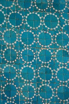 Little square tiles in blue with white sun pattern