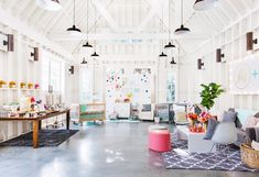 I LOVE how bright, airy, and colorful this living room is!  It would also make a fantastic craft room or retail space.  I just love it! #brightliving room #whitewalls #whitelivingroom