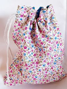 Great little drawstring bag. Suitable for just about anything but make up or toiletries spring to mind. Fully lined with turquoise blue fabric. Made of cotton. Toiletry Bag, Blue Fabric, Flower Designs, Pretty In Pink, Pink Flowers, Drawstring Backpack, Essentials, Buy And Sell, Etsy Shop