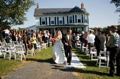 A historic house in the background adds vintage appeal to this outdoor wedding ceremony. {High Point Events}