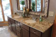 Dark cabinetry with a light top - perfect for a large bathroom!    Midwest Stone Source + Design Studio   815.395.8677  #woodcabinetry #granite #RockfordIL #MidwestStoneSource MidwestStoneSource.com