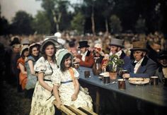 Friends and families don top hats or bonnets for a social gathering in Schreiberhau, Germany, in 1928.