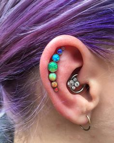 Somewhere over the rainbow. Well my Monday morning just became fabulous! Beautiful opal cluster by @anatometalinc, piercing by me at @oldlondonroadtattoos on the lovely @becca_rowe_1990 Thank you for...