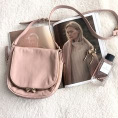 Vince Camuto cross body BLUSH bag Vince Camuto bag. ⭐️Light pink soft leather. Brand new! Very tiny pink pen mark next to zipper ( see third pic) Ask me if you need more pic! Let me know if you're interested. Vince Camuto Bags Crossbody Bags