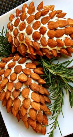 Pine Cone Cheese Ball Recipe ~ Made of herbed cream cheese and decorated with toasted almonds... It's so simple that your kids could help you decorate it, but so clever your guests will love it.
