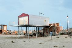 container house on stilts by the beach