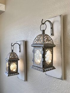 Cheap wall decor idea. Indoor/outdoor lantern with bracket used for ...