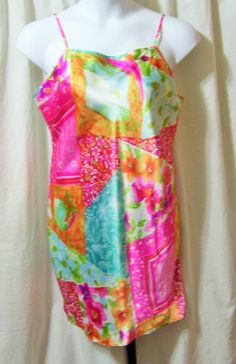 Summery and bright in a wonderful liquid satin that floats over your body. Pristine - no issues or flaws to state  Size Extra Large   Fabric: 100% polyester satin Care: Washable Label: Victoria Secret  PLEASE ASK YOUR QUESTIONS PRIOR TO ORDERING.