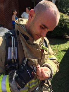 Baby Squirrel Runs Out Of Burning House Straight Into Firefighter's Arms