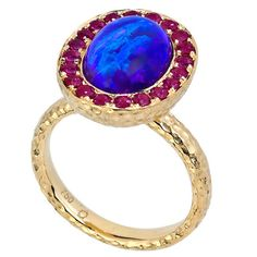 Katherine Jetter Antiquity II Ring Gold with Rubies and Opal | From a unique collection of vintage cocktail rings at https://www.1stdibs.com/jewelry/rings/cocktail-rings/