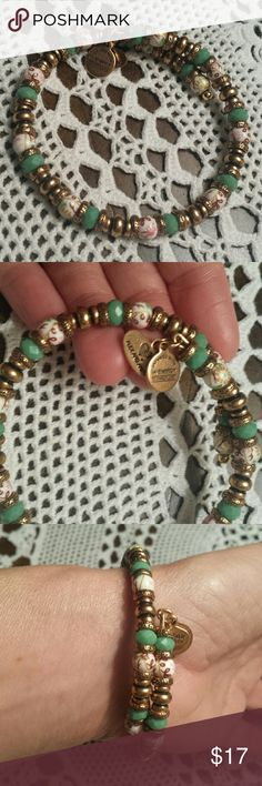 Super cute Alex and Ani bracelet I'm more of a vintage rarity sterling type of girl, but this Alex & Ani glass and brass shabby chic inspired bracelet is pretty rad.  Charms say infused with energy technology and vintage sixty-six. Alex & Ani Jewelry Bracelets