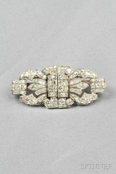 Art Deco Platinum and Diamond Dress Clips, each set with fancy-, old European-, and single-cut diamonds, approx. total wt. 6.20 cts., millegrain accents, 14kt white gold mount for brooch conversion, lg. 2 1/4 in.